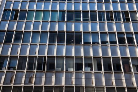 Weathered windows modern city office building
