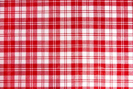 Red checkered tablecloth fabric background texture, close-up. Stock Photo