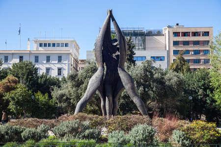 Athens Greece, April 17. 2018: Statue of 'Memorial of National Reconciliation' by Vassilis Doropoulos (1987) on Klafthmonos Square Editorial