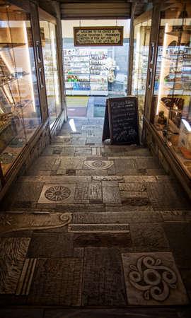 Athens Greece: April 17. 2018: Entrance to Athens souvenir shop with interesting vintage flooring mosaic