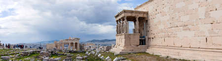 Athens.Greece.April 17, 2018.Erechteion temple on the Acropolis hill in Athens wisiting by group of tourists. Editorial