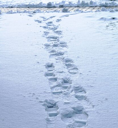Footsteps on the snow Stock Photo