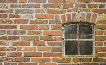brick wall with a small window