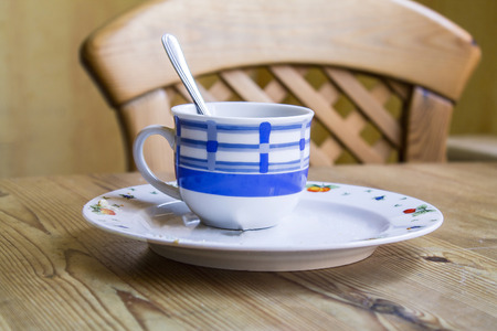 cup on a plate on wooden table Stock Photo