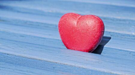 heart between blue wooden planks