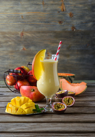 juice glass: Healthy diet tropical mango melon and passion fruit smoothie with yogurt for breakfast vitamin drink