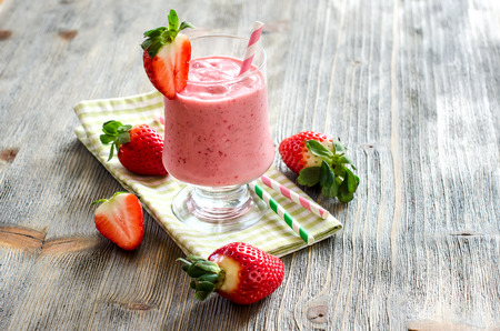 fruit shake: Milk shake with strawberries on wooden copy space background Stock Photo