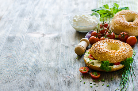 Bagels sandwiches wtih cream cheese, tomatoes and chives  Stock Photo