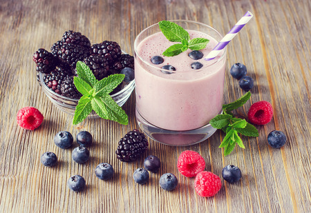 Smoothie with blackberries, raspberries and blueberries, healthy summer dessert