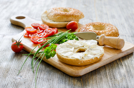 Bagels sandwiches wtih cream cheese, tomatoes and chives for healthy snack