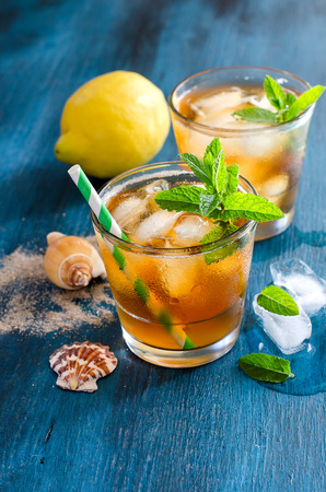 picnic food: Fresh cold iced tea with mint, ice cibes and lemons, refreshing summer drink