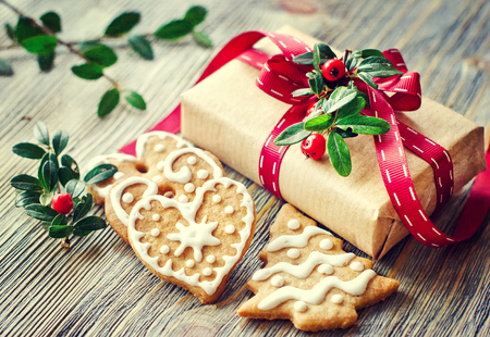 Heart shaped cookies with icing decoration and a present box Archivio Fotografico