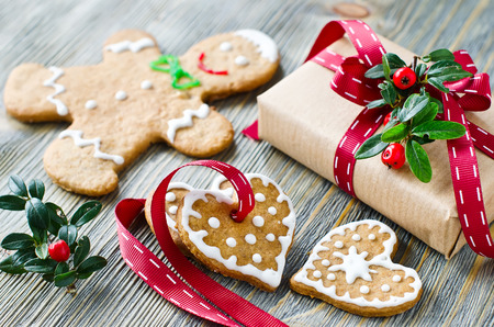 Gingerman and heart shaped cookies with icing decoration and a present box
