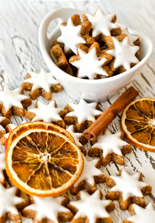 white winter: Winter holiday sweets on white wooden background Stock Photo