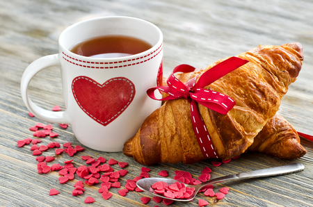 party food: Valentines breakfast with heart shape decoration Stock Photo