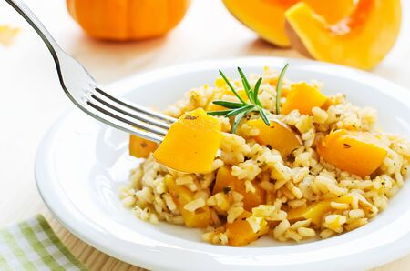 rice plate: Rice dish with pumpkin, risotto on the plate for healthy dinner