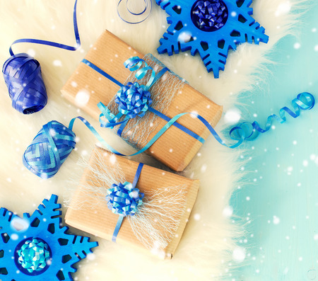 text space: Vintage chrismtas gift boxes on blue background, falling snow effect, festive decortaion concept copy space Stock Photo