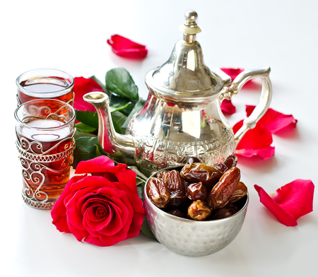 square image: Tea and rose on white background square image