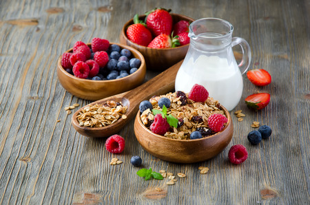 rolled oats: Breakfast with rolled oats and berries in wooden bowls