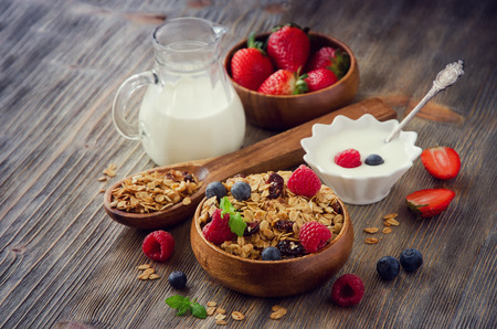 rolled oats: Healthy reakfast with rolled oats and berries in wooden bowls