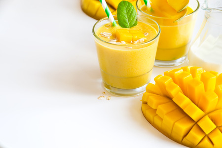 Healthy drink with yogurt and mango sample text background