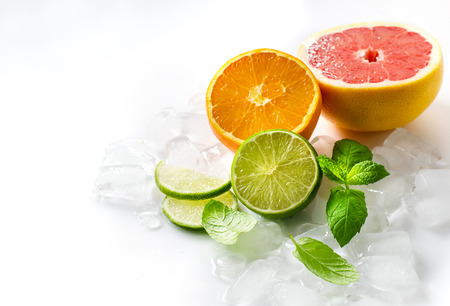 Lime, orange and grapefruit on white background selective focus Standard-Bild