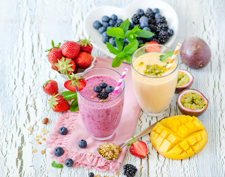 Berry smoothie, healthy summer detox yogurt drink, diet or vegan food concept, fresh vitamins, homemade refreshing cocktail Banco de Imagens - 60675065