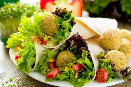 Tortilla wrap with falafel and fresh salad, vegetarian healthy food, vegan concept