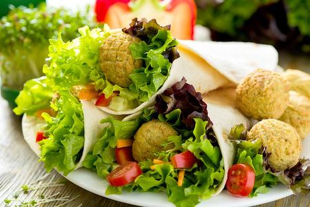 Tortilla wrap with falafel and fresh salad, vegetarian healthy food, vegan concept