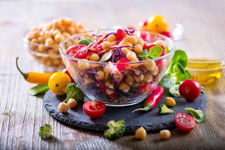 Healthy homemade fresh chickpea and veggies salad, diet, vegetarian, vegan food, vitamin snack