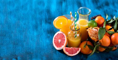 fruits juice: Citrus juice with fruits, grapefruit, lime, orange, copy space background