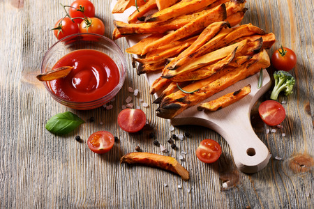 healthy snack: Healthy homemade sweet potato fries, vegan vegetarian snack with ketchup Stock Photo