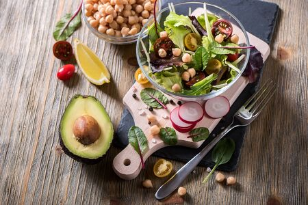 Healthy green salad with chickpeas and avocado, mangold leaves.. Vegan snack, vitamins, vegetarian food and diet concept