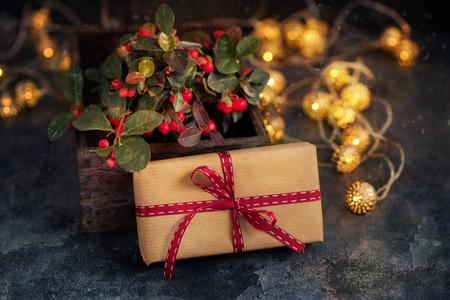 Christmas gift or present box with sparkling bokeh lights Stock Photo