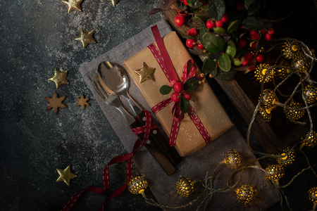 Christmas table setting with gift or present box for festive dinner