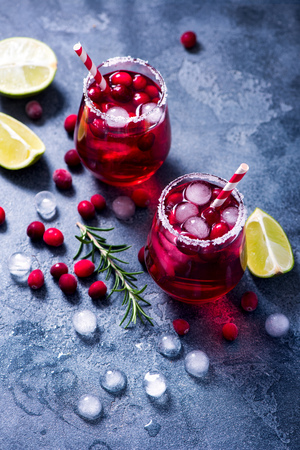 Cold cranberry cocktail with lime and rosemary, festive drink, punsh