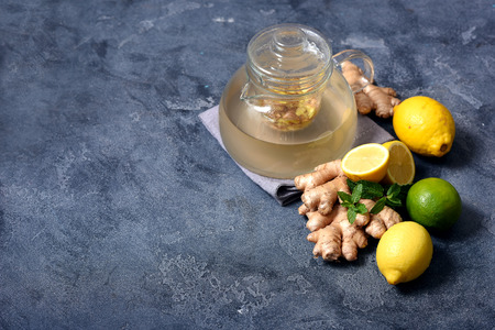 Healthy ginger tea, hot vitamin drink with lemons, copy space background
