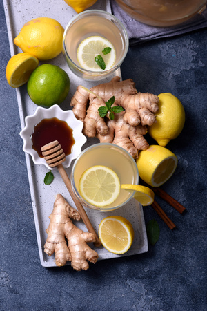 Healthy ginger tea, hot vitamin drink with lemons Stock Photo