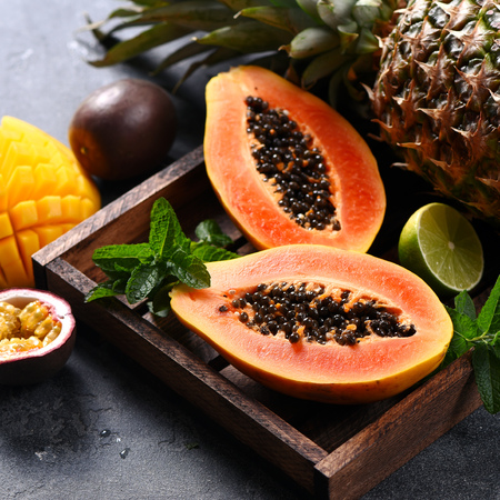 Papaya fruit, sweet ripe fresh papaya, mango, pine apple, tropical fruits, raw vegan food, square image