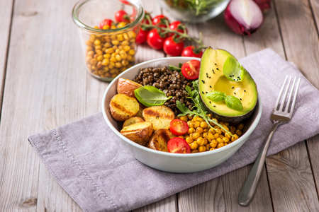 Buddha bowl with baked potatoes, lentils and spicy chickpeas, avocado, arugula, vegan, vegetarian healthy food