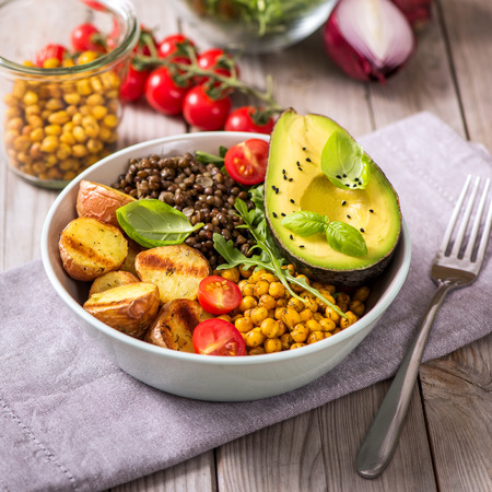 Buddha bowl with baked potatoes, lentils and spicy chickpeas, avocado, arugula, vegan, vegetarian healthy food , square image