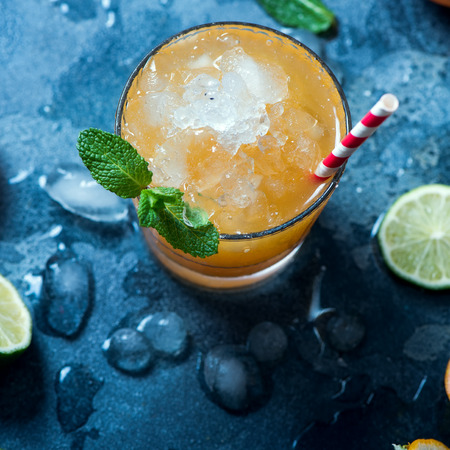 Refreshing cocktail with crashed ice, juicy summer party drink with citrus fruits