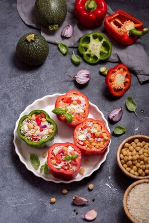 Stuffed peppers or paprika with rice and chickpeas, vegetarian lunch, vegan cooking, healthy and clean eating