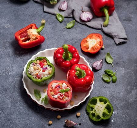 Stuffed peppers or paprika with rice and chickpeas, vegetarian lunch, vegan cooking, healthy dinner, clean eating, square image Banco de Imagens