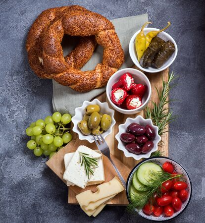 Traditional turkish or oriental snack, breakfast with olives, simit bagels, feta cheese, stuffed wine leaves and antipasti
