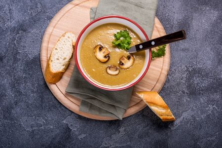 Champignon mushroom cream soup, delicious vegetable soup, healthy vegetarian and vegan food