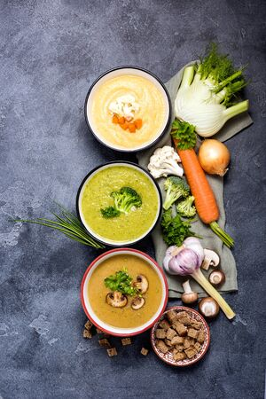 Different vegan soups with vegetables, clean eating, dieting and healthy food concept. Fennel and cauliflower soup, mushroom soup and broccoli soup