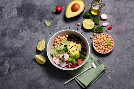 Fresh chickpea and lentil salad with veggies and avocado, vegan lunch bowl or healthy snack, clean eanting and detox food concept