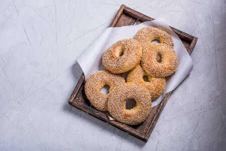 Fresh baked bagels in wooden box copy space background