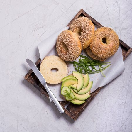 Bagels, bagel sandwiches with avocado,  healthy snack, top view, brunch or breakfast time